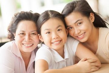young family smiling & hugging l general dentistry farmington nm